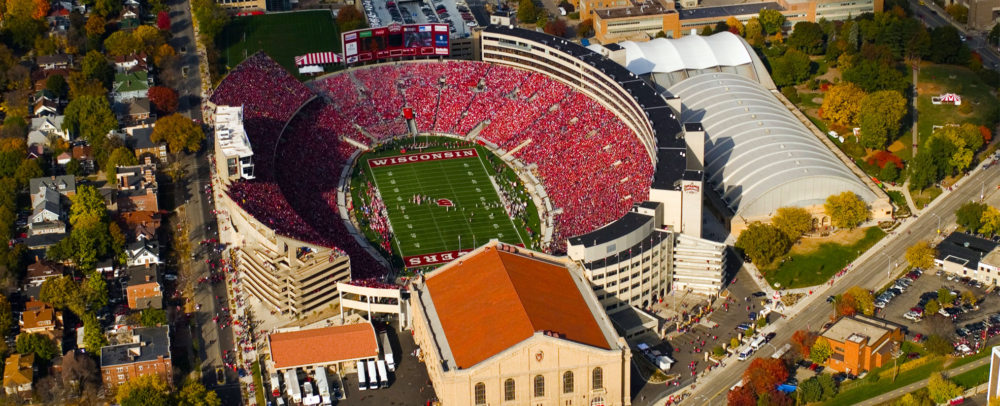 An ariel photo of a more modern Camp Randall complex from 2015 that contains Camp Randall Stadium, the Field House, The SHELL, and surrounding buildings.
