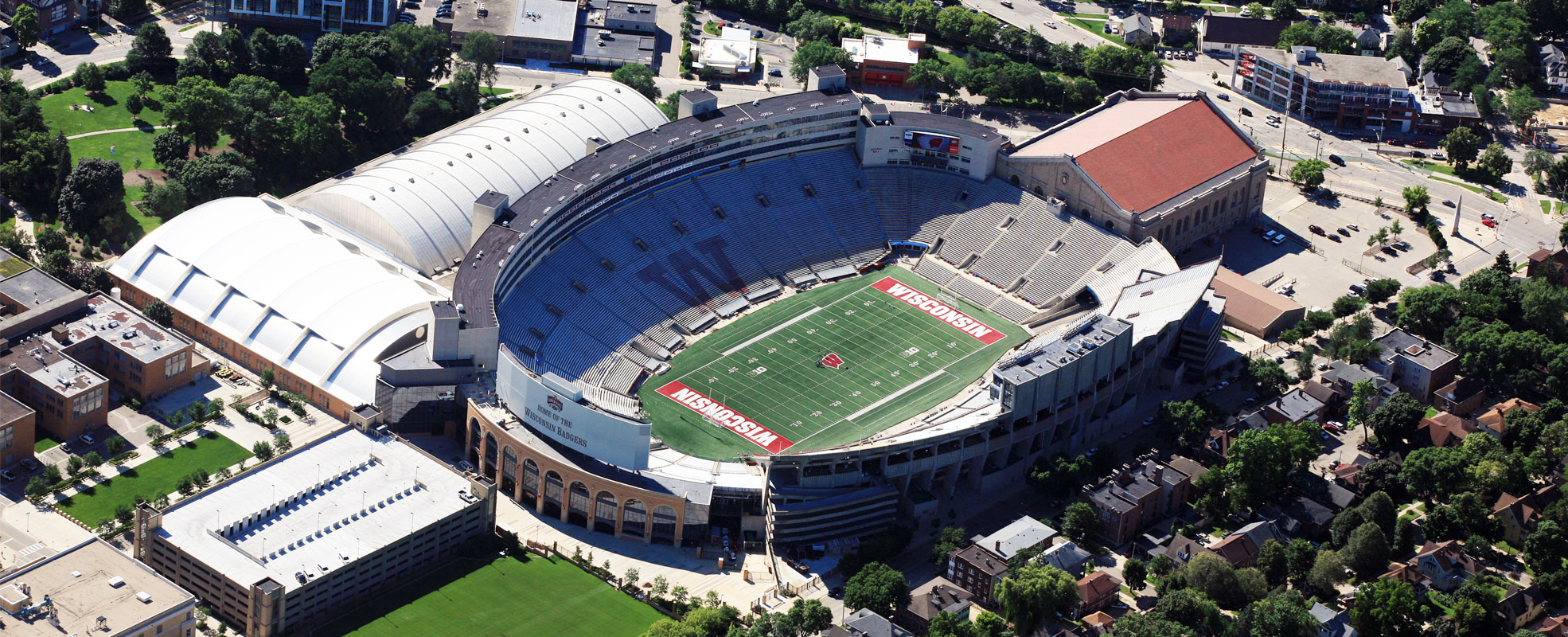 An ariel photo of a more modern Camp Randall complex from 2015 that contains Camp Randall Stadium, the Field House, The SHELL, and surrounding buildings but not during a game.